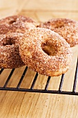 Doughnuts with cinnamon sugar on a wire rack