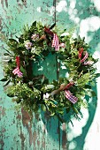 Wreath of herbs with red gingham ribbons