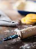 A still life featuring a rolling pin