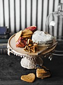Stuffed heart-shaped Brie with fruit and rosemary crackers