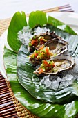 Oysters with Mediterranean salsa and lemon juice