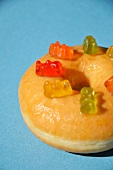 A doughnut decorated with gummy bears