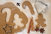 Gingerbread Man and Candy Cane Cut From Cookie Dough; Star Cookie Cutter