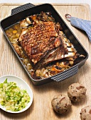 Roast pork ribs with mushroom dumplings and potato salad
