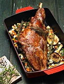 Roast leg of lamb on a bed of vegetables