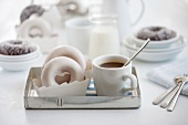 Doughnut and a cup of coffee on a tray