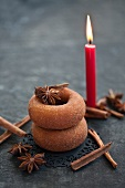 Doughnuts with cinnamon, star anise and a candle