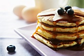 Stack of Pancakes with Maple Syrup and Blueberries