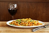 Penne Pasta Dish with a Glass of Red Wine