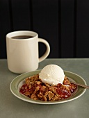 Serving of Rhubarb Cobbler Topped with a Scoop of Ice Cream; Cup of Coffee