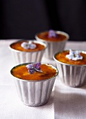 Individual Creme Bruless in Tins with Sugared Flower Blossom Garnishes