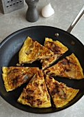 Frittata Sliced in a Skillet