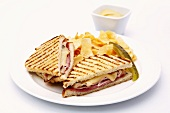 Ham and Cheese Panini with Potato Chips and a Pickle