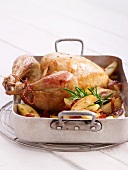 Roast chicken with sauerkraut stuffing and potatoes