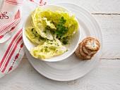 Lettuce leaves and a herb vinaigrette