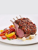 Rack of lamb with a tomato and olive crust and a pepper medley