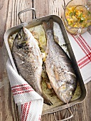 Sea bream in a roasting tin