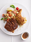 Chicken leg and beef steak with risoni and tomatoes