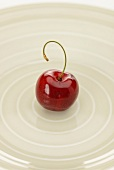 A cherry with a bent stalk