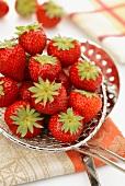 Fresh strawberries on a draining spoon