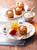 Rhubarb tartlets with whipped cream and mango puree