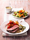 Roast beef with a potato and tomato ragout and a spring salad