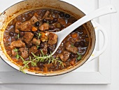 Lamb ragout with olives and savory