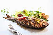Fried sea bream with mushrooms and a side salad