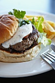 A lamb burger with yogurt sauce