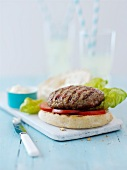 Turkey burger with tomatoes and lettuce (Italy)