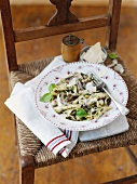 Pasta ai funghi (pasta with mushrooms and Bechamel sauce, Italy)