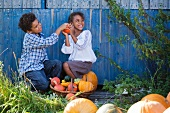 Children playing with pumpkins