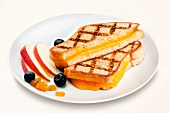 Halved Grill Cheese Sandwich on a White Plate with Fruit