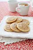 Anise Lemon Butter Cookies on a Plate; Cup of Tea
