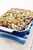 Baked Penne, Chicken and Mushroom Casserole in Casserole Dish; Serving Spoon
