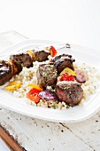 Beef Kabobs with Onions and Peppers Over Israeli Couscous