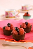 Mini chocolate bowls with raspberries and ganache