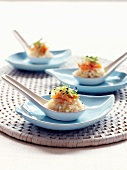 Lemon risotto with crab and onion sprouts on spoons