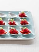 Rhubarb granita on strawberry slices