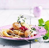 Spaghetti with scallops and raspberry sauce