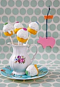 Cake pops decorated with colourful chocolate beans