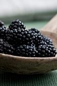 Blackberries in an old wooden ladle