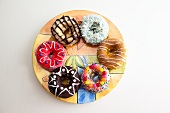 An Assortment of Doughnuts on a Round Plate; From Above