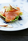 A slice of wholemeal bread topped with smoked salmon