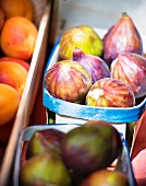 Fresh figs and apricots on a market stand