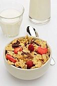 Cornflakes with dried fruit and chocolate and a glass of milk
