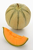 A whole cantaloupe melon and a wedge
