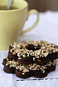 Cocoa biscuits with chocolate glaze and chopped hazelnuts