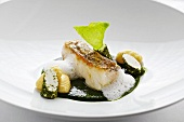 Fried hake in ramson sauce