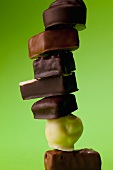 Chocolate pralines against a green background